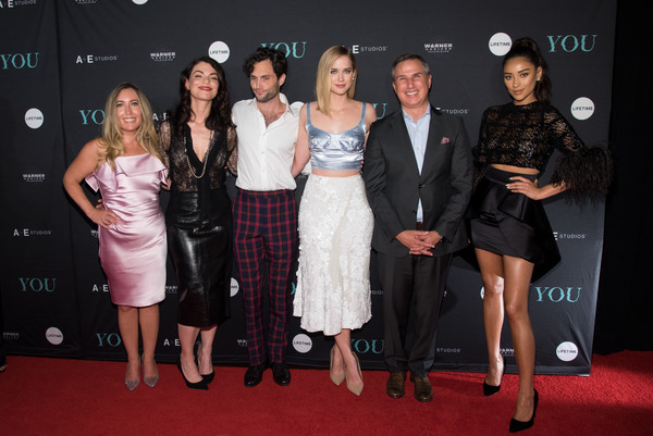 'You' Series Premiere Celebration [carpet,red carpet,fashion,event,dress,little black dress,premiere,flooring,cocktail dress,fashion design,you series premiere celebration,l-r,a e networks,sera gamble,caroline kepnes,president,elizabeth lail,penn badgley,shay mitchell,paul buccieri]