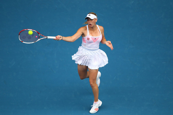 Caroline Wozniacki Caroline Wozniacki of Denmark plays a forehand in her first round match against Gisela Dulko of Argentina during day one of the 2011 Australian Open at Melbourne Park on January 17, 2011 in Melbourne, Australia.