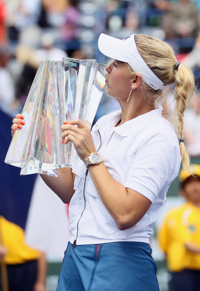 Caroline Wozniacki Caroline Wozniacki of Denmark kisses the trophy following her victory over Marion Bartoli of France during the finals of the BNP Paribas Open at the Indian Wells Tennis Garden on March 20, 2011 in Indian Wells, California.