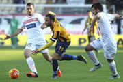 Giampaolo Pazzini (C) of Hellas Verona FC competes for the ball with Andrea Lazzari (L) and Nicolas Federico Spolli (R) of Carpi FC during the Serie A match between Carpi FC and Hellas Verona FC at Alberto Braglia Stadium on November 1, 2015 in Modena, Italy.