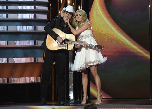 Carrie Underwood Hosts Brad Paisley and Carrie Underwood speak onstage during the 48th annual CMA awards at the Bridgestone Arena on November 5, 2014 in Nashville, Tennessee.