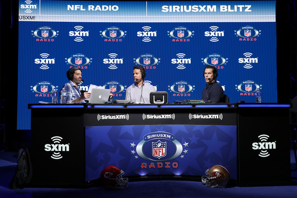 SiriusXM At Super Bowl LIV - Day 1 [display device,news,technology,news conference,world,carson palmer,bruce murray,brady quinn,l-r,miami,florida,siriusxm,nfl,super bowl,day one,ed mccaffrey,solomon wilcots,nfl,danny kanell,minnesota vikings,super bowl,american football,denver broncos,wide receiver,defensive end]