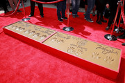 """Cement with the handprints of Johnny Galecki, Jim Parsons, Kaley Cuoco, Simon Helberg, Kunal Nayyar, Mayim Bialik and Melissa Rauch from the cast of """"The Big Bang Theory"""" is seen during their handprint ceremony at the TCL Chinese Theatre IMAX  on May 1, 2019 in Hollywood, California."""