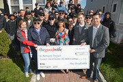 """(EXCLUSIVE COVERAGE) (13 from L-R) Actors Josh Charles,  Jerry Adler, Julianna Margulies, Chris Noth, Archie Panjabi, Matt Czuchry, Zach Grenier present a check to the St. Bernard Project as The Cast Of """"The Good Wife"""" Celebrate Their100th Episode With A Day Of Service For The St. Bernard Project on October 26, 2013 in New York City."""