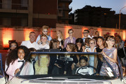 Fashion designers, founders and owners of Dan Caten and Dean Caten with kid models attend the Caten Hight Shool Prom Dsquared2 as a part of Pitti Bimbo Kids Fashion Week at Palamattioli on June 21, 2018 in Florence, Italy.