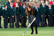 Catherine, Duchess of Cambridge takes part in a day of activities and festivities to mark the occasion of St Andrew's Day at St Andrew's School on November 30, 2012 in Pangbourne, Berkshire, England. During her visit, the Duchess visited the Pre-Prep School for under-5s, unveiled a plaque to officially open a new artificial turf playing field and met members of the school's hockey team, which she played for during her time as a pupil at the school (1986-1995). The Duchess also toured the school privately and watched the school's Progressive Games which are traditional games played indoors by teachers and students on St. Andrew's Day.