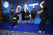 """(L-R) Laurie Davidson, Rebel Wilson, Larry Bourgeois, Jennifer Hudson, Francesca Hayward, Jason Derulo and Laurent Bourgeois attend the """"Cats"""" photocall at The Corinthia Hotel on December 13, 2019 in London, England."""