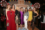 "(L-R) Sarah Drew, Rachel Boston, Megan Hilty, Melissa Joan Hart, Toni Braxton, Tiya Sircar and Bethany Joy Lenz attend the VIP opening night of the life-sized gingerbread house in celebration of ""It's A Wonderful Lifetime"" at The Grove on November 14, 2018 in Los Angeles, California."