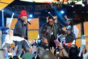 (L-R)Pharrell Williams, Busta Rhymes, and Snoop Dogg perform onstage at the 63rd NBA All-Star Game 2014 at the Smoothie King Center on February 16, 2014 in New Orleans, Louisiana.