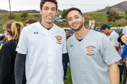 """Christian Yelich and Ryan Braun attend a charity softball game to benefit """"California Strong"""" at Pepperdine University on January 13, 2019 in Malibu, California."""