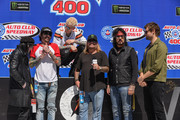 Mick Mars, Tommy Lee, Machine Gun Kelly, Vince Neil, Nikki Sixx and Douglas Booth attend the Monster Energy NASCAR Cup Series race at Auto Club Speedway at Auto Club Speedway on March 17, 2019 in Fontana, California.