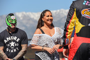 Rey Mysterio and Adrienne Bailon attend the Monster Energy NASCAR Cup Series race at Auto Club Speedway at Auto Club Speedway on March 17, 2019 in Fontana, California.