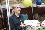 Emma Roberts attends the Celebrity friends of Feeding America give back at the Para Los Niños Felices Fiestas to celebrate the holidays and raise awareness around the issue of hunger at Para Los Ninos Gratts Primary Center on December 14, 2019 in Los Angeles, California.