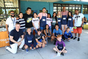 (Back Row) Jonathan Bennet (5thL), Ali Larter (5thR), Boris Kodjoe (4thR), Emily Tosta (2ndR) and guests attend Celebrity Friends Of Feeding America volunteer at The Santa Monica Boys and Girls Club to raise awareness around summer hunger at Santa Monica Boys and Girls Club on July 17, 2019 in Culver City, California.