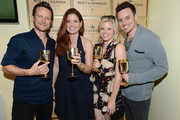 (L-R) Actor Will Chase, Debra Messing,  Megan Hilty and Brian Gallagher attend the Moet & Chandon Suite at USTA Billie Jean King National Tennis Center on August 30, 2013 in New York City.