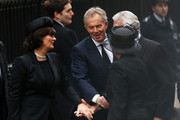 Former British Prime Ministers Tony Blair (C) and John Major with their wives Norma Major and Cherie Blair (L) attend the Ceremonial funeral of former British Prime Minister Baroness Thatcher at St Paul's Cathedral on April 17, 2013 in London, England. Dignitaries from around the world today join Queen Elizabeth II and Prince Philip, Duke of Edinburgh as the United Kingdom pays tribute to former Prime Minister Baroness Thatcher during a Ceremonial funeral with military honours at St Paul's Cathedral. Lady Thatcher, who died last week, was the first British female Prime Minister and served from 1979 to 1990.