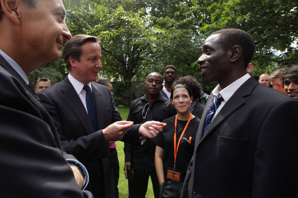 Spanish Prime Minister Jose Luis Rodriguez Zapatero (L) and British Prime Minister David Cameron (2nd L) speak to young people during a reception in the garden of 10 Downing Street on July 25, 2011 in London, England. The event was organised to mark the graduation of young people involved in the Street League football Academy, a charity helping young people change their lives through football.