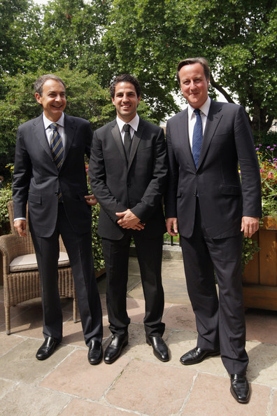Arsenal and Spanish international footballer Cesc Fabregas (C), Spanish Prime Minister Jose Luis Rodriguez Zapatero (L) and British Prime Minister David Cameron attend a reception in the garden of 10 Downing Street on July 25, 2011 in London, England. The event was organised to mark the graduation of young people involved in the Street League football Academy, a charity helping young people change their lives through football.