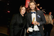 Honoree Megan Ellison (L) and Champagne Tattinger's Brand Ambassador Jordane Andreiu attend the Screen Actors Guild Foundation 30th Anniversary Celebration, with Champagne Taittinger, at Wallis Annenberg Center for the Performing Arts on November 5, 2015 in Beverly Hills, California.