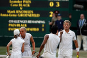 Mark Knowles of Bahamas (R) and Anna-Lena Groenefeld of Germany (2L) shake hands with runners up Leander Paes of India (2R) and Cara Black of Zimbabwe (L) after the mixed doubles final match  on Day Thirteen of the Wimbledon Lawn Tennis Championships at the All England Lawn Tennis and Croquet Club on July 5, 2009 in London, England.