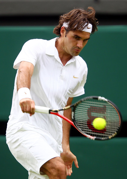 Roger Federer of Switzerland plays a shot during his first round match against Alejandro Falla of Columbia on Day One of the Wimbledon Lawn Tennis Championships at the All England Lawn Tennis and Croquet Club on June 21, 2010 in London, England.