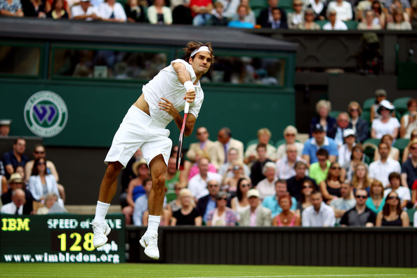 Roger Federer of Switzerland serves during his first round match against Alejandro Falla of Columbiaon Day One of the Wimbledon Lawn Tennis Championships at the All England Lawn Tennis and Croquet Club on June 21, 2010 in London, England.