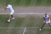 Mark Knowles of Bahamas plays a forehand playing with Anna-Lena Groenefeld of Germany during the mixed doubles semi final match against Jamie Murray of Great Britain and Liezel Huber of USA on Day Eleven of the Wimbledon Lawn Tennis Championships at the All England Lawn Tennis and Croquet Club on July 3, 2009 in London, England.