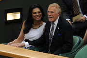 Sir Bruce Forsyth and his wife Wilnelia arrive in the Royal Box on Centre Court during Day Three of the Wimbledon Lawn Tennis Championships at the All England Lawn Tennis and Croquet Club on June 22, 2011 in London, England.
