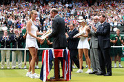 Prince Edward, Duke of Kent presents Petra Kvitova of the Czech Republic  the Championship trophy after winning her Ladies' final round match against Maria Sharapova of Russia on Day Twelve of the Wimbledon Lawn Tennis Championships at the All England Lawn Tennis and Croquet Club on July 2, 2011 in London, England.  Kvitova won 6-3 6-4.