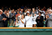 Prince Edward, Duke of Kent, Billie Jean King and LTA president Peter Bretherton look on as Kveta Peschke of the Czech Republic and Katarina Srebotnik of Slovenia hold up their championship trophies after winning their final round Ladies' doubles match against  Sabine Lisicki of Germany and Samantha Stosur of Australia on Day Twelve of the Wimbledon Lawn Tennis Championships at the All England Lawn Tennis and Croquet Club on July 2, 2011 in London, England.