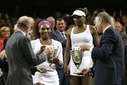 Serena Williams and Venus Williams of the USA receive their winners trophies from Prince Edward, Duke of Kent (L) after winning their Ladies? Doubles final match against Andrea Hlavackova and Lucie Hradecka of the Czech Republic on day twelve of the Wimbledon Lawn Tennis Championships at the All England Lawn Tennis and Croquet Club on July 7, 2012 in London, England.