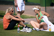 Sabine Lisicki of Germany laughs as she talks with Barbara Rittner, captain of the German Fed Cup team during a practice session on day eleven of the Wimbledon Lawn Tennis Championships at the All England Lawn Tennis and Croquet Club on July 5, 2013 in London, England.