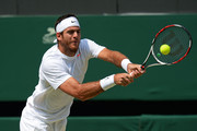 Juan Martin Del Potro of Argentina plays a backhand during the Gentlemen's Singles semi-final match against Novak Djokovic of Serbia on day eleven of the Wimbledon Lawn Tennis Championships at the All England Lawn Tennis and Croquet Club on July 5, 2013 in London, England.