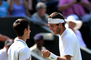 Juan Martin Del Potro of Argentina talks with Novak Djokovic of Serbia during the Gentlemen's Singles semi-final match on day eleven of the Wimbledon Lawn Tennis Championships at the All England Lawn Tennis and Croquet Club on July 5, 2013 in London, England.