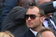 Jude Law watches the Gentlemen's Singles semi-final match between Novak Djokovic of Serbia and Juan Martin Del Potro of Argentina on day eleven of the Wimbledon Lawn Tennis Championships at the All England Lawn Tennis and Croquet Club on July 5, 2013 in London, England.
