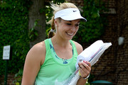 Sabine Lisicki of Germany smiles as she arrives for a practice session on day eleven of the Wimbledon Lawn Tennis Championships at the All England Lawn Tennis and Croquet Club on July 5, 2013 in London, England.
