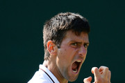Novak Djokovic of Serbia reacts during the Gentlemen's Singles semi-final match against Juan Martin Del Potro of Argentina on day eleven of the Wimbledon Lawn Tennis Championships at the All England Lawn Tennis and Croquet Club on July 5, 2013 in London, England.