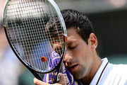 Novak Djokovic of Serbia wipes his face with a towel during the Gentlemen's Singles semi-final match against Juan Martin Del Potro of Argentina on day eleven of the Wimbledon Lawn Tennis Championships at the All England Lawn Tennis and Croquet Club on July 5, 2013 in London, England.
