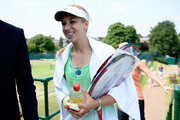 Sabine Lisicki of Germany smiles as she leaves a practice session on day eleven of the Wimbledon Lawn Tennis Championships at the All England Lawn Tennis and Croquet Club on July 5, 2013 in London, England.