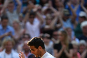 Juan Martin Del Potro of Argentina waves to the crowd as he leaves Centre Court following his defeat in the Gentlemen's Singles semi-final match against Novak Djokovic of Serbia  on day eleven of the Wimbledon Lawn Tennis Championships at the All England Lawn Tennis and Croquet Club on July 5, 2013 in London, England.