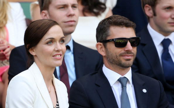 Victoria Pendleton and fiance Scott Gardner attned the Gentlemen's Singles third round match between Richard Gasquet of France and Bernard Tomic of Australia on day six of the Wimbledon Lawn Tennis Championships at the All England Lawn Tennis and Croquet Club on June 29, 2013 in London, England.