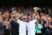 Mike Bryan and Bob Bryan of the United States of America pose with the Gentlemen's Doubles Trophies following their victory in the Gentlemen's Doubles final match against Ivan Dodig of Croatia and Marcelo Melo of Brazil on day twelve of the Wimbledon Lawn Tennis Championships at the All England Lawn Tennis and Croquet Club on July 6, 2013 in London, England.