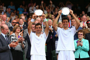 Ivan Dodig of Croatia and Marcelo Melo of Brazil pose with their runners-up trophies following their defeat in the Gentlemen's Doubles final match against Mike Bryan and Bob Bryan of the United States of America on day twelve of the Wimbledon Lawn Tennis Championships at the All England Lawn Tennis and Croquet Club on July 6, 2013 in London, England.