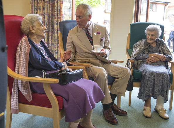 Charles, Prince of Wales, Patron, the Almshouse Association meets 92 year old twins Phyll Franlin and Gladys Care as he visits the St John and St Anne Almshouse on July 28, 2014 in Oakham, England. Their Royal Highnesses met residents partaking in some of the community activities and toured the facilities.