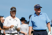 (L-R) Bernhard Langer of Germany and Colin Montgomerie of Scotland stand in the first tee box during round one of the Charles Schwab Cup Championship on the Cochise Course at The Desert Mountain Club on October 30, 2014 in Scottsdale, Arizona.
