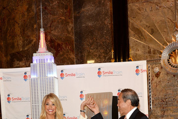 Charles Wang Christie Brinkley Visits The Empire State Building to Celebrate 'Give a Smile, Get a Smile' Launch