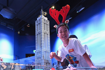 Charlie Rose Children Add Finishing Touches to Life Size LEGO Christmas Showcase