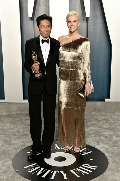 2020 Vanity Fair Oscar Party Hosted By Radhika Jones - Arrivals [suit,formal wear,fashion,tuxedo,dress,haute couture,event,fashion design,style,gown,radhika jones - arrivals,radhika jones,kazuhiro tsuji,charlize theron,beverly hills,california,wallis annenberg center for the performing arts,oscar party,vanity fair,kazuhiro tsuji,radhika jones,bombshell,wallis annenberg center for the performing arts,vanity fair,oscar party,vanity fair: hollywood calling,90th academy awards,celebrity,party]
