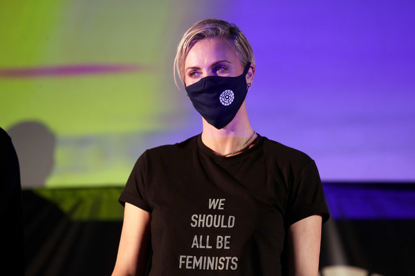 """Charlize Theron Hosts Drive-In Screening Of """"Mad Max: Fury Road"""" Benefiting The Charlize Theron Africa Outreach Project [mad max: fury road,purple,yellow,t-shirt,fun,facial hair,headgear,photography,neck,beard,flash photography,t-shirt,charlize theron hosts drive-in screening,charlize theron,musician,artist,charlize theron africa outreach project,purple,yellow,the grove,t-shirt,musician,artist]"""