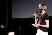 """Charlize Theron speaks onstage at Charlize Theron Hosts Drive-In Screening of """"Mad Max: Fury Road"""" Benefiting the Charlize Theron Africa Outreach Project at The Grove on July 31, 2020 in Los Angeles, California."""